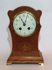 Inlaid Oak case mantle clock